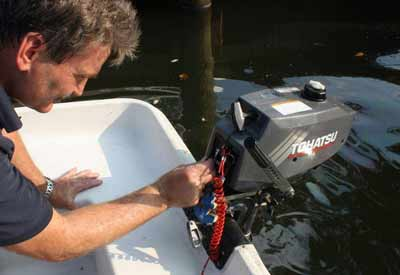a man powering on an outboard motor