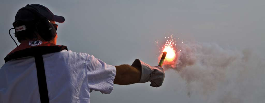 a person holding a red flare