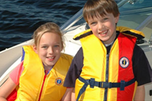 Two kids wearing lifejackets