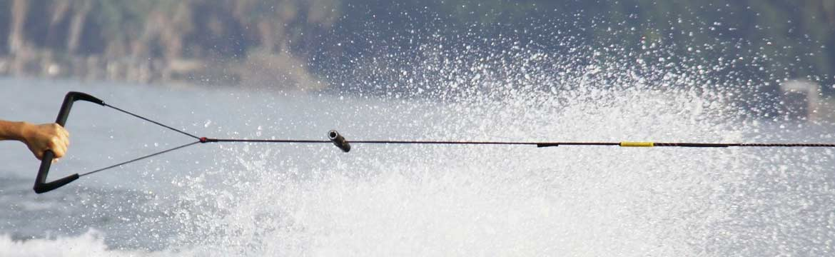 a man waterskiing holds on to his rope