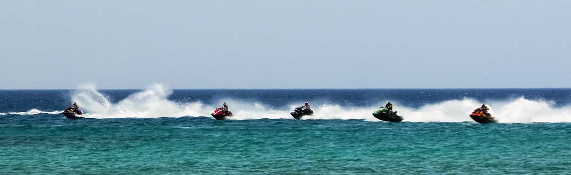 a group of jetski racers racing